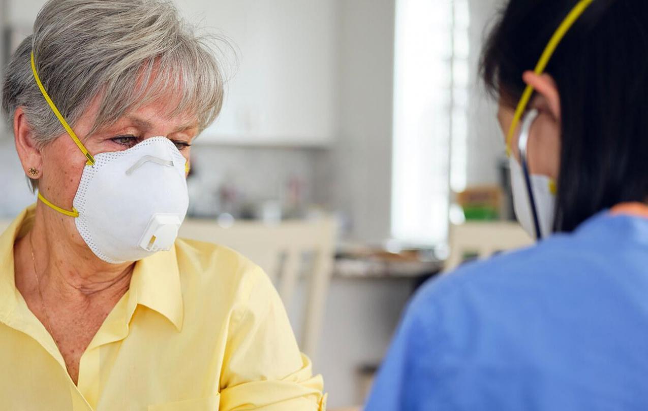 Elderly woman in face mask